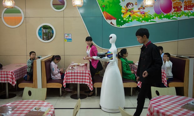 a robot waiter makes her rounds in Kunshan in 2016