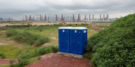 BT 201806 Last words Portable toilets are seen in front of skyscrapers at the Qianhai special economic zone in Shenzhen