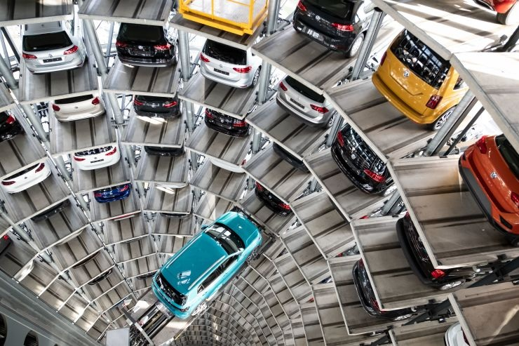 The Volkswagen T Cross model stands on a lifting platform in a car tower on the Volkswagen factory premises